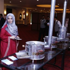 Administrative Officer, SEC briefs a delegate on SAARC Improved Cooking Stoves (ICS) at HVDC Workshop, Lahore, Pakistan